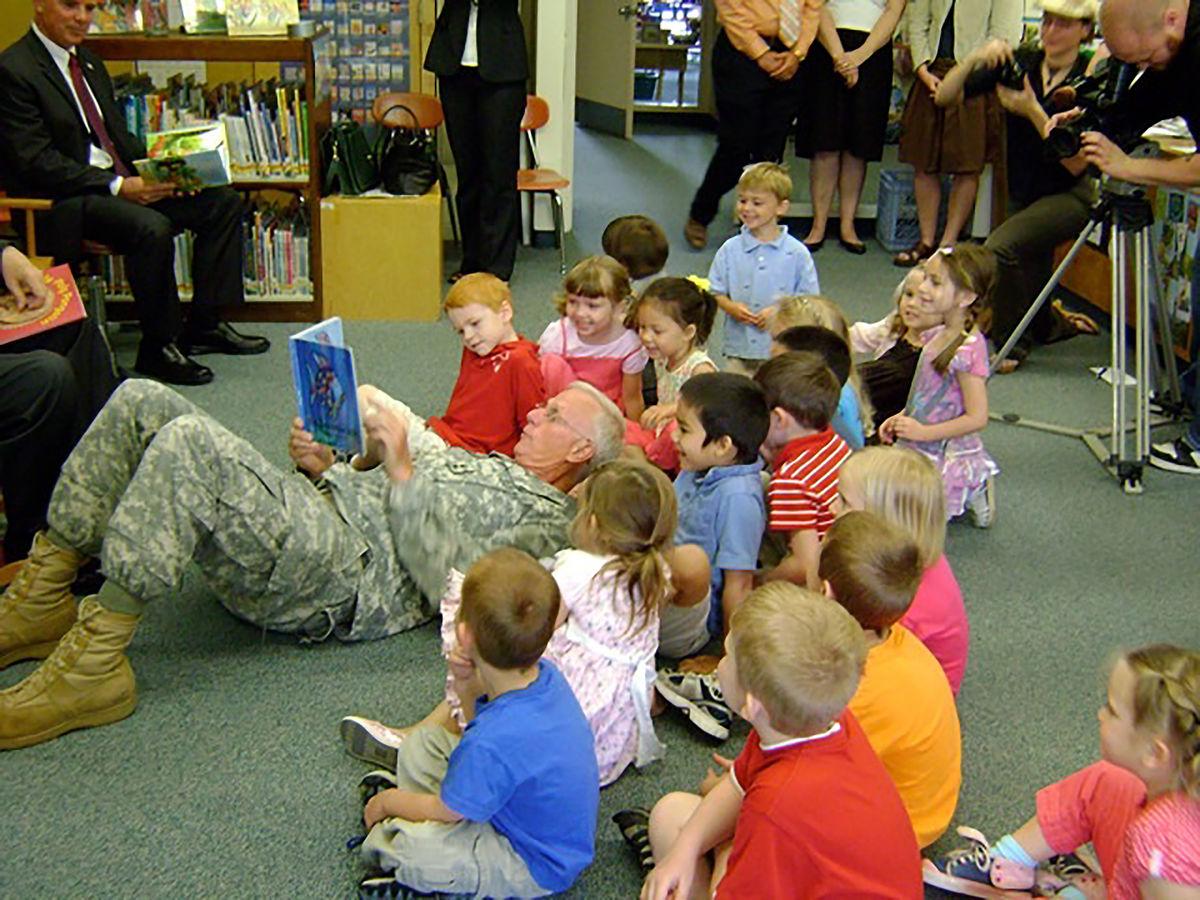 Major General Bill Libby reading with PreK students in Bangor