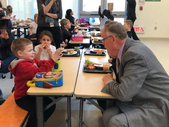 Admiral Loy eating lunch with students