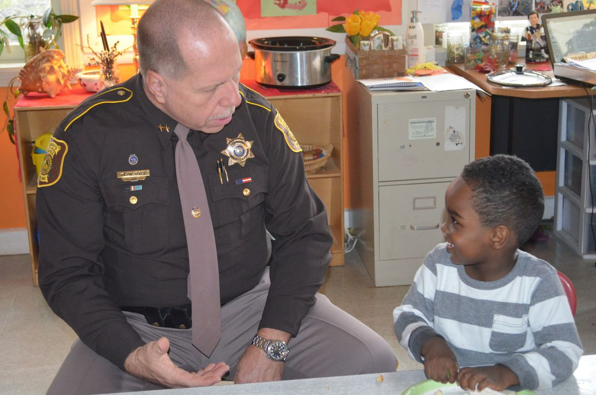 Cumberland County Sheriff Kevin Joyce talks with a student at the Catherine Morrill Day Nursery in Portland during a recent visit.