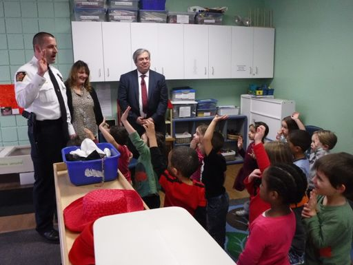 "Then-Allentown Police Chief Glen Dorney (now South Whitehall Township Police Chief) ""deputizes"" pre-schoolers at a March 23, 2018 pre-k press conference in Allentown as Sen. Pat Browne, Chairman of the Senate Appropriations Committee, looks on."