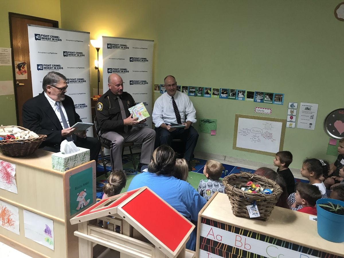 Rep Moolenaar and members reading with kids