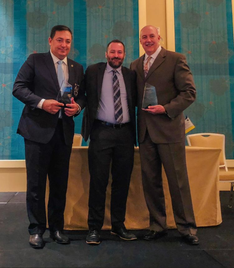 Chief Mike Brown and Chief Art Acevedo accept the 2018 Crime Fighter Award from National Director Josh Spaulding