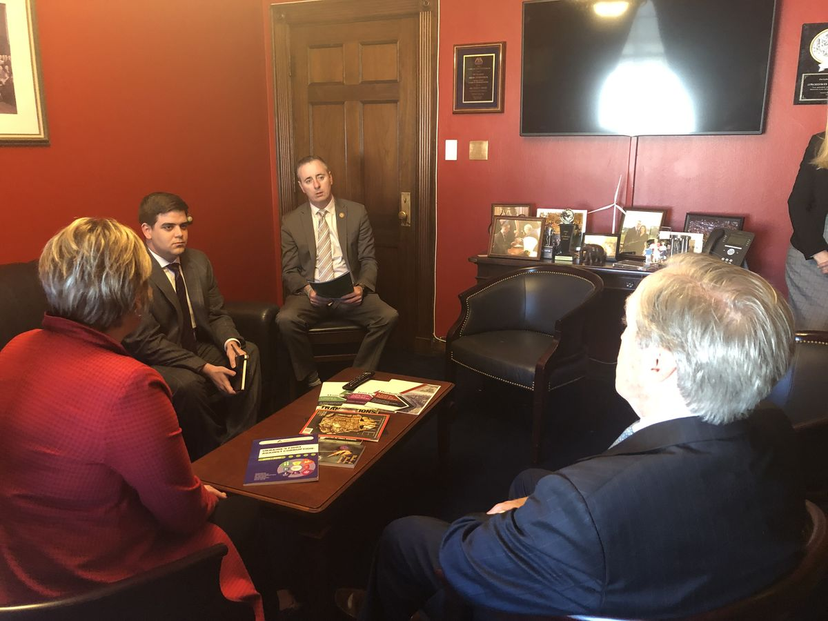 ReadyNation members Stephanie Doliveira and Jack Brennan (R) discuss the child care crisis with Rep. Brian Fitzpatrick (R-PA) on 3/26/19.