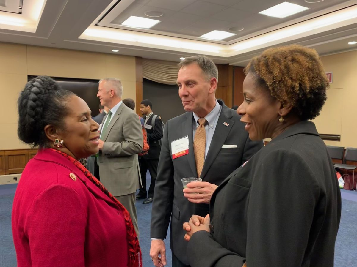 Rep. Sheila Jackson Lee (D-TX) speaks with Mission: Readiness members Major General (Ret.) Jeff Phillips and Brigadier General (Ret.) Allyson Solomon during Capitol Hill reception