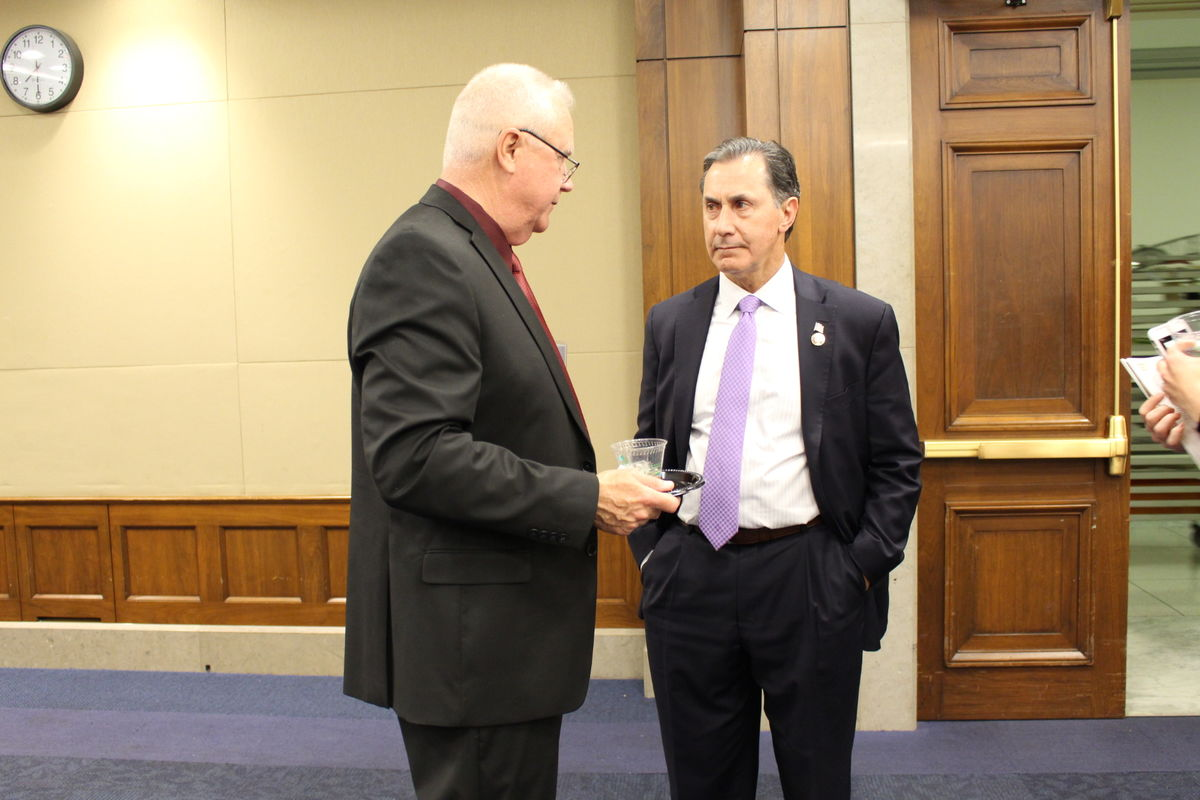 Brigadier General (Ret.) Douglas Satterfield speaks with Rep. Gary Palmer (R-AL) during Capitol Hill reception