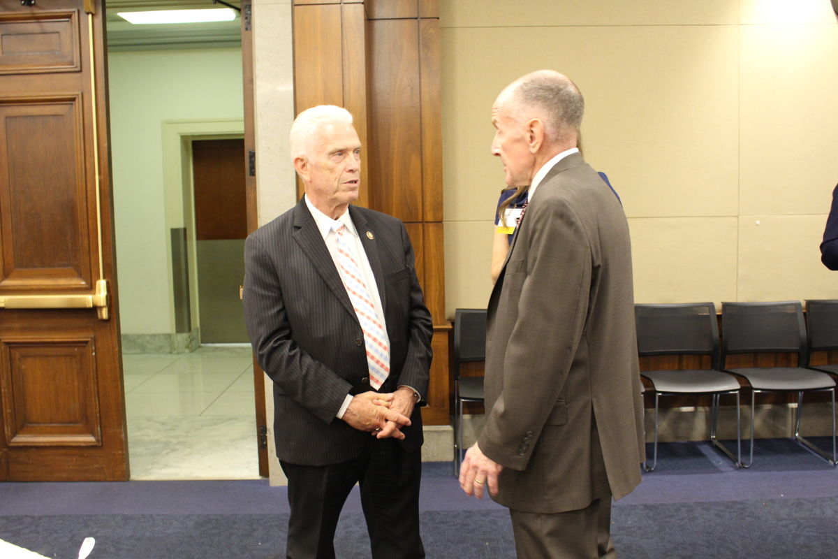 Rep. Bill Johnson (R-OH) speaks with Lieutenant General (Ret.) Norman Seip during Capitol Hill reception