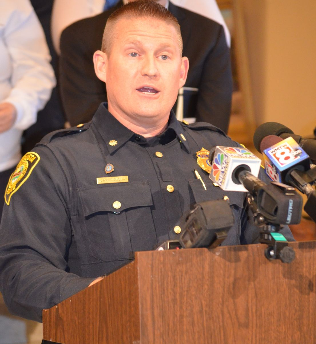 Augusta Maine Police Chief Jared Mills speaks at the state capitol