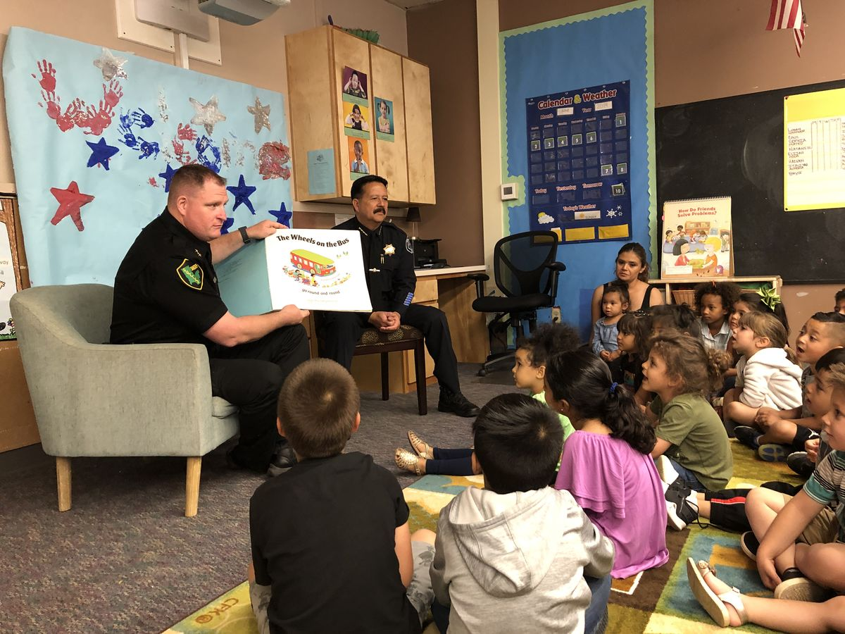 "Yuba City Police Chief Robert Landon and Sutter County Undersheriff Scott Smallwood Read ""Wheels on the Bus"" to Preschool Students at Bernard Children's Center"