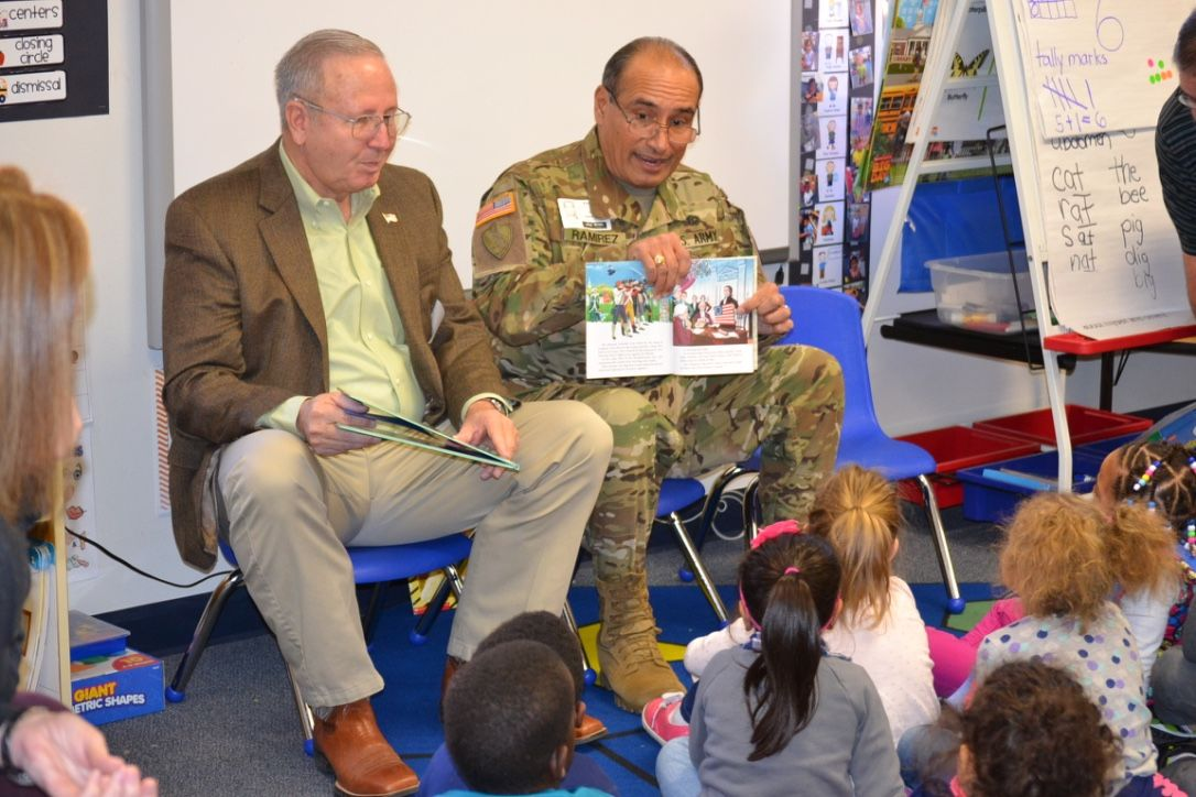 MG Darren Owen and BG Joe Ramirez reading with kids