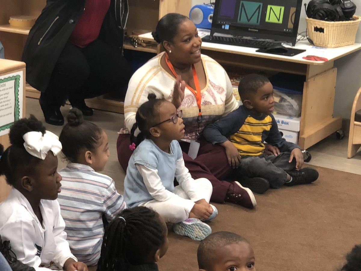 School kids and teacher listening