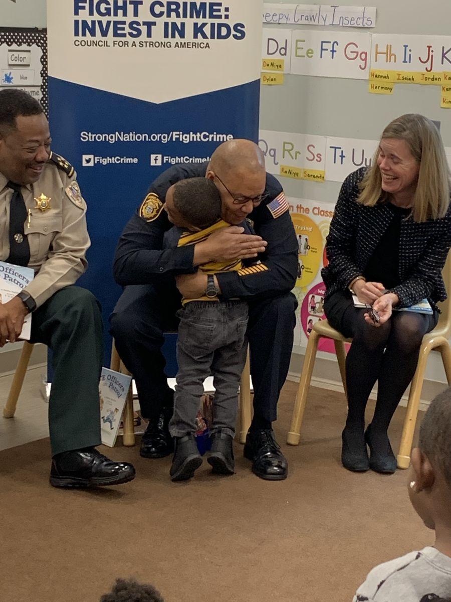 Sheriff Bonner hugs a child
