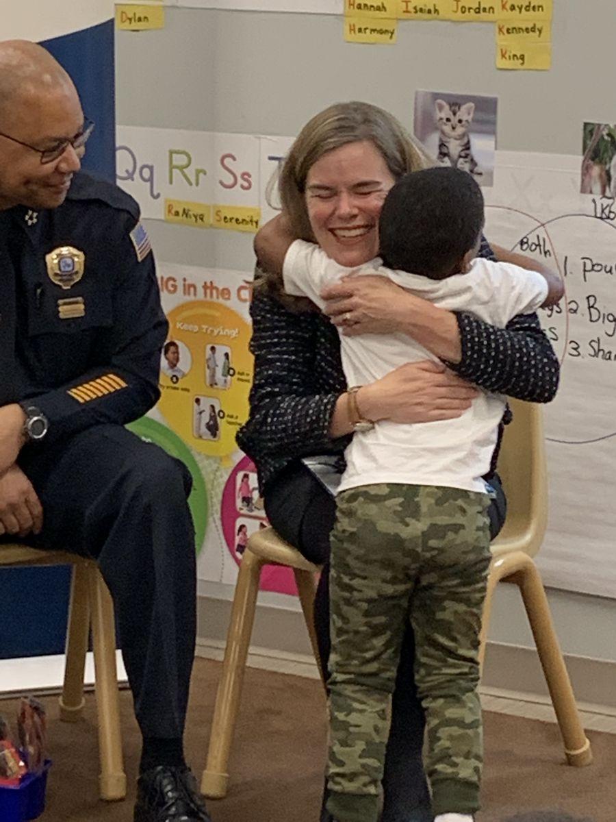 DA Amy Weirich hugs child
