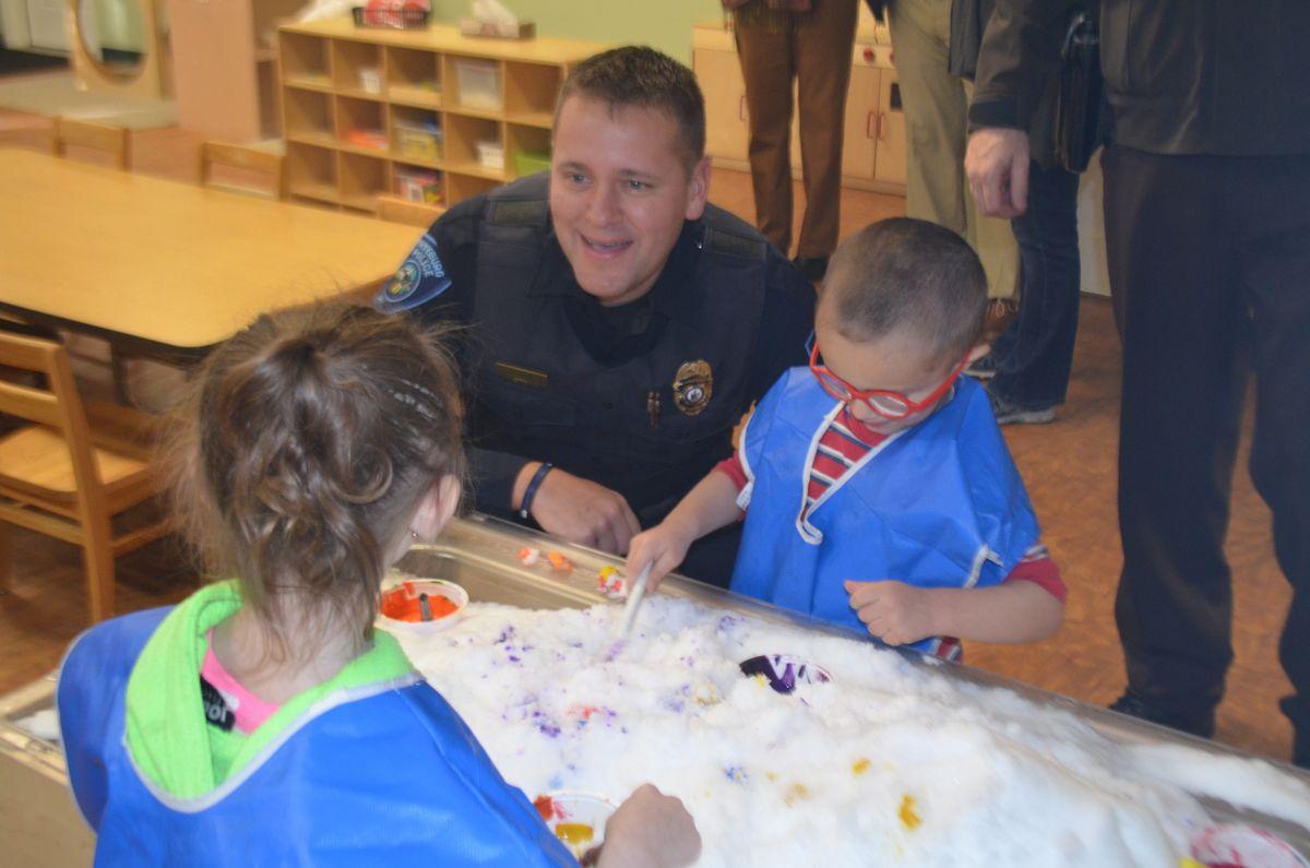 Fryeburg Chief of Police Joshua Potvin interacts with students of the Fryeburg Head Start and the Molly Ockett Elementary School PreK.