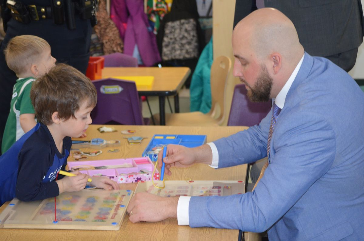 Maine State Senator Matt Pouliott with a student of Head Start's Magic Year Early Learning Center in Augusta.