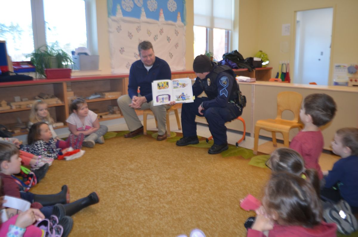 School Resource Officer Sgt. Heidi Johnston and Maine State Rep. Nathan Wadsworth read to students of the Fryeburg Head Start and the Molly Ockett Elementary School PreK.
