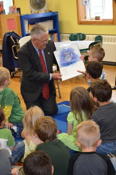Major General Earl Adams, U.S. Army (retired) reading with PreK students in Bangor
