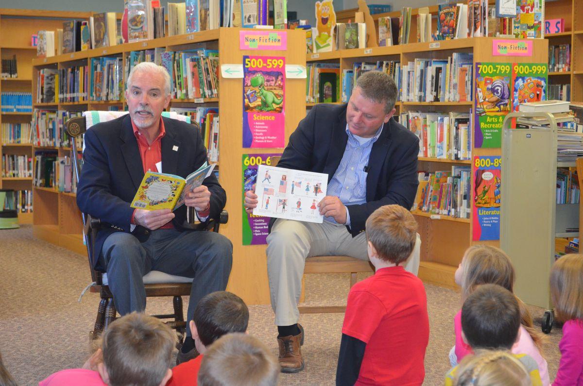 BG Robert Carmichael reading to preschoolers