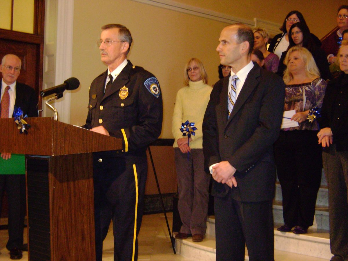 March 23, 2009: Former Camden Chief of Police Phil Roberts and former Maine Governor John Baldacci in a Hall of Flags ceremony at the State House issuing the Governor's Proclamation making April 2009 the official Child Abuse and Neglect Prevention Month
