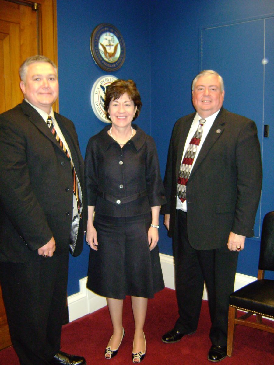Former Houlton Chief of Police Butch Asselin and former Winthop Chief of Police Joe Young with Senator Susan Collins