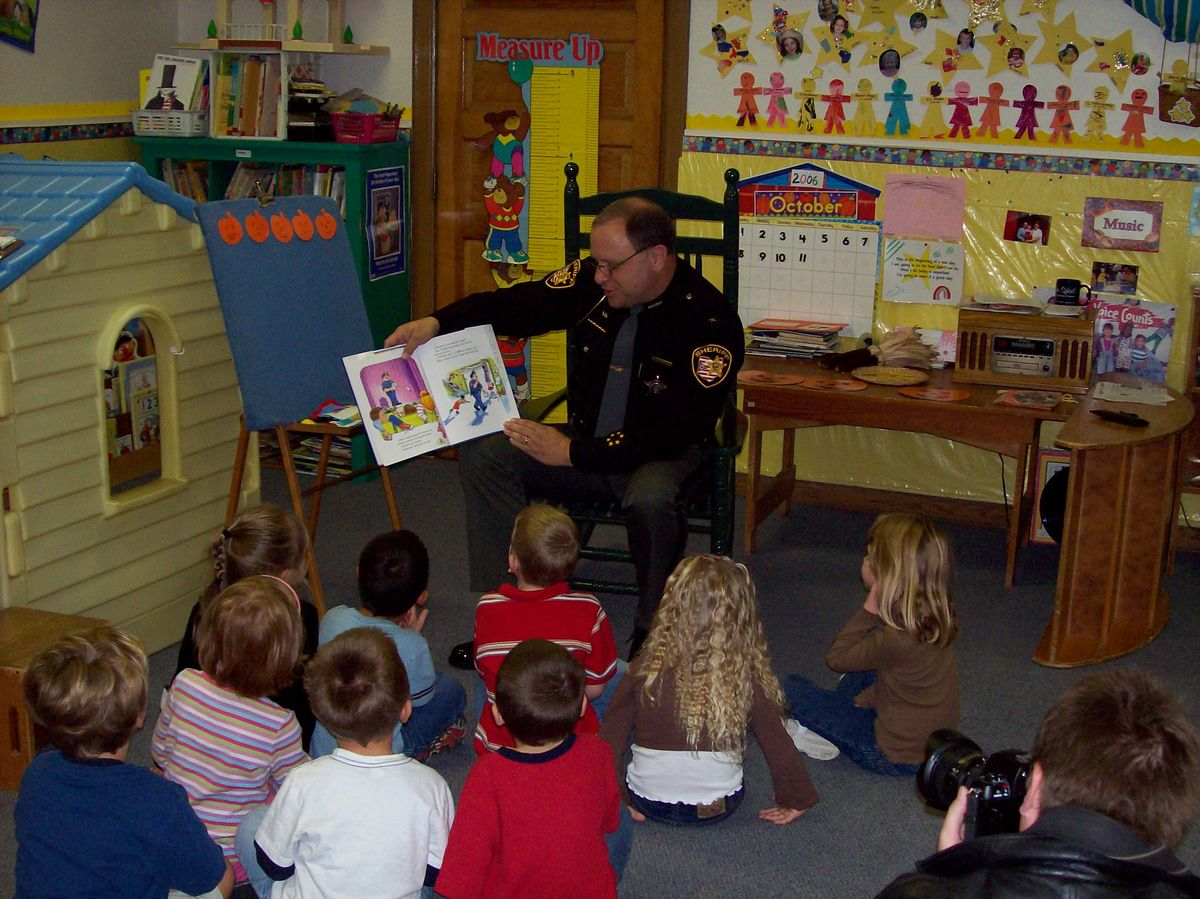 Wayne County Sheriff Tom Mauer at Cops and Tots preschool reading event in Wooster, OH.