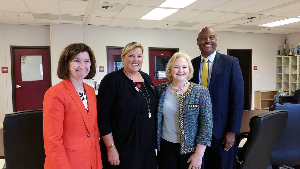 Vice Admiral Jody Breckenridge, Ret., U.S. Coast Guard, Oakland Military Institute Superintendent Johnna Grell, Alameda County District Attorney Nancy O'Malley and Alameda County Chief of Inspectors Robert Chenault pose for photo at Oakland Military Visit.