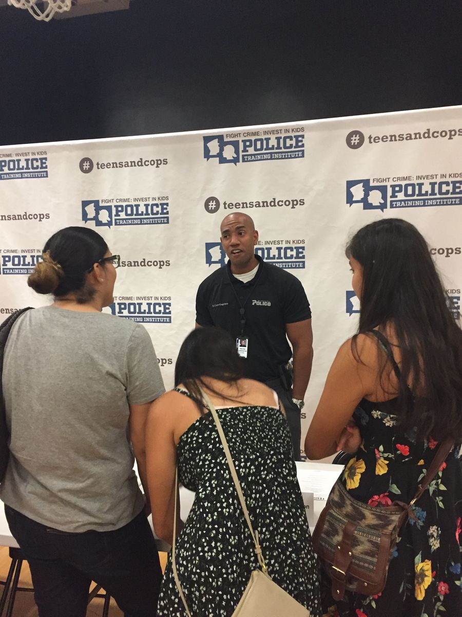 San Bernardino Police Detective Nelson Carrington talks with students after Town Hall panel.