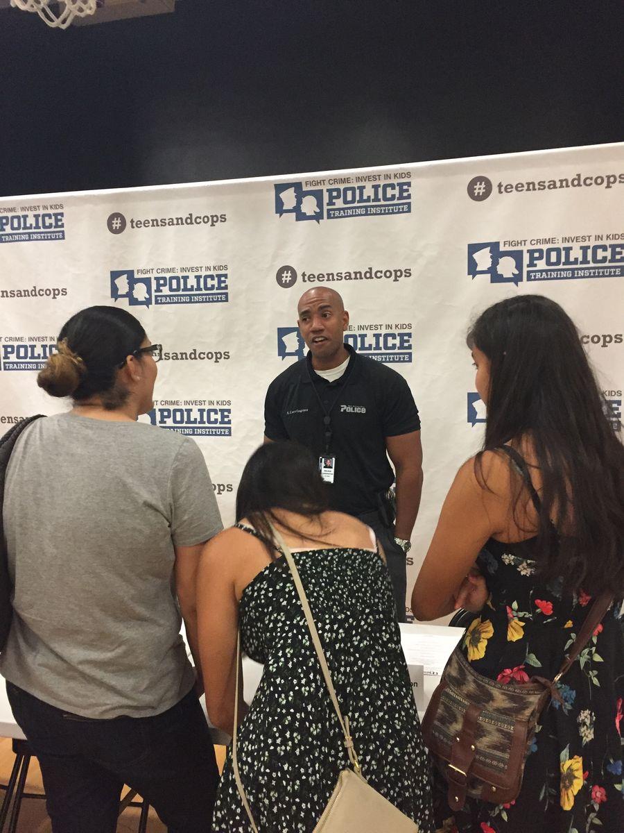 San Bernardino Police Detective Nelson Carrington talks with students after Town Hall panel.