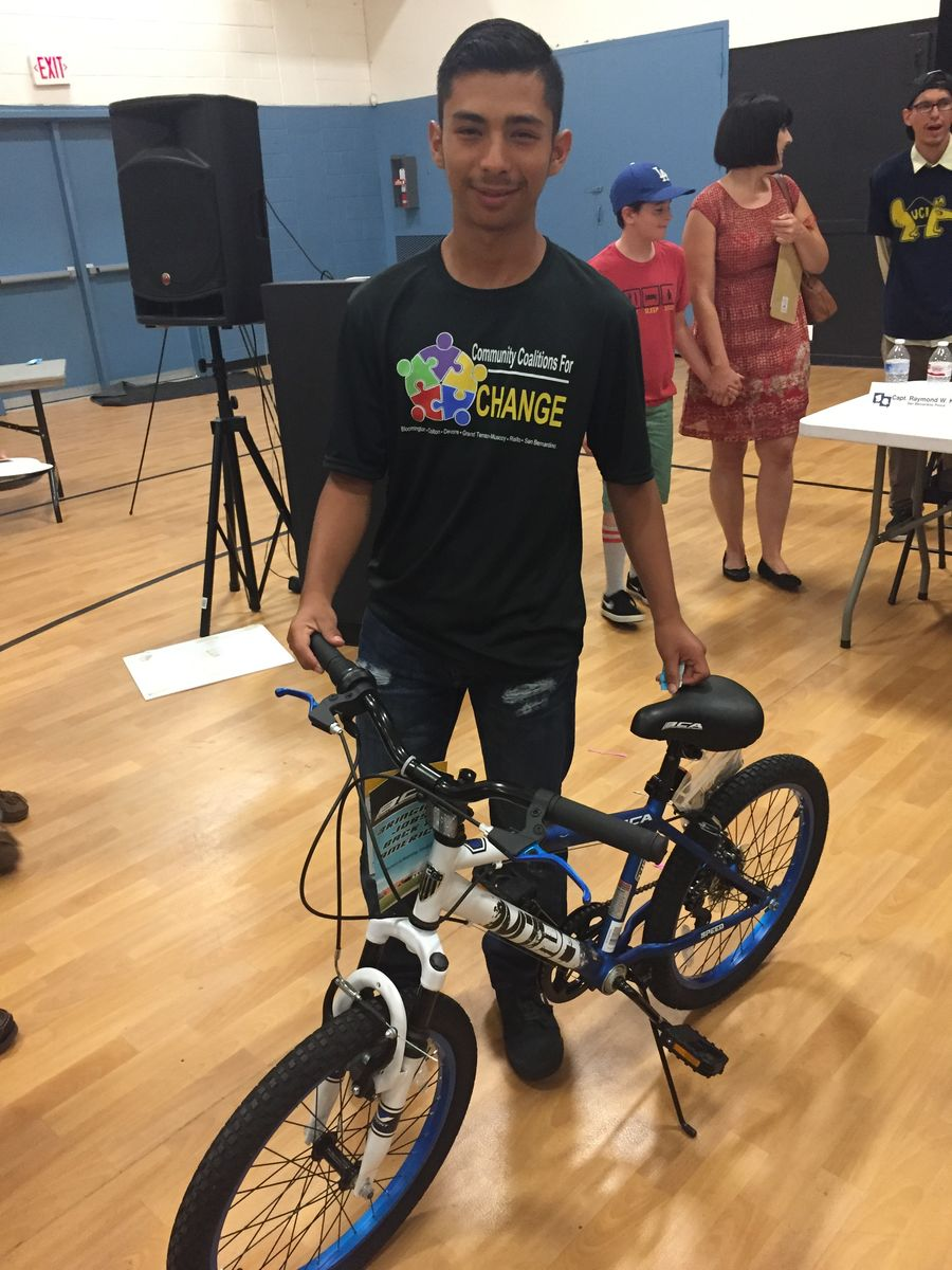 Ruben poses with the bike that he won at the San Bernardino Town Hall event.