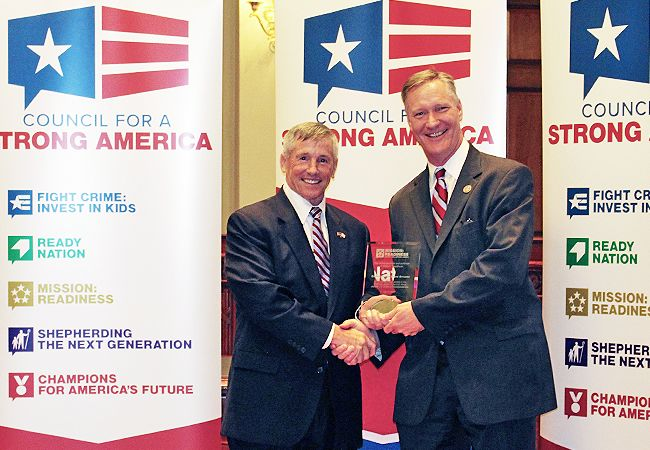 Lieutenant General (Ret.) Mick Bednarek, on behalf of the retired generals and admirals of Mission: Readiness, presents plaque to Congressman Steve Stivers for his service in the Ohio National Guard and U.S. House of Representatives