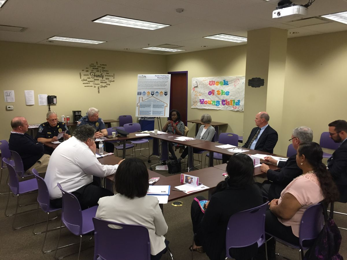 Towamencin Township Police Chief Tim Dickinson and Upper Gwynedd Township Police Chief David Duffy are joined by Sen. John Rafferty, Reps. Matt Bradford, Tim Briggs, Michael Corr, home visiting providers and participating parents at a home visiting roundtable in Norristown on May 25, 2017.