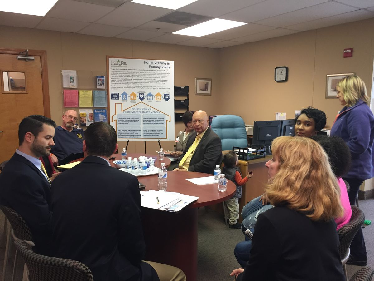 Monroe County Sheriff Todd Martin joins Sen. Mario Scavello in Stroudsburg on May 11, 2017 at the Nurse-Family Partnership program office to discuss home visiting in the state budget. Also participating were staff for Rep. Rosemary Brown, NFP program officials, and participating parents with their young children.