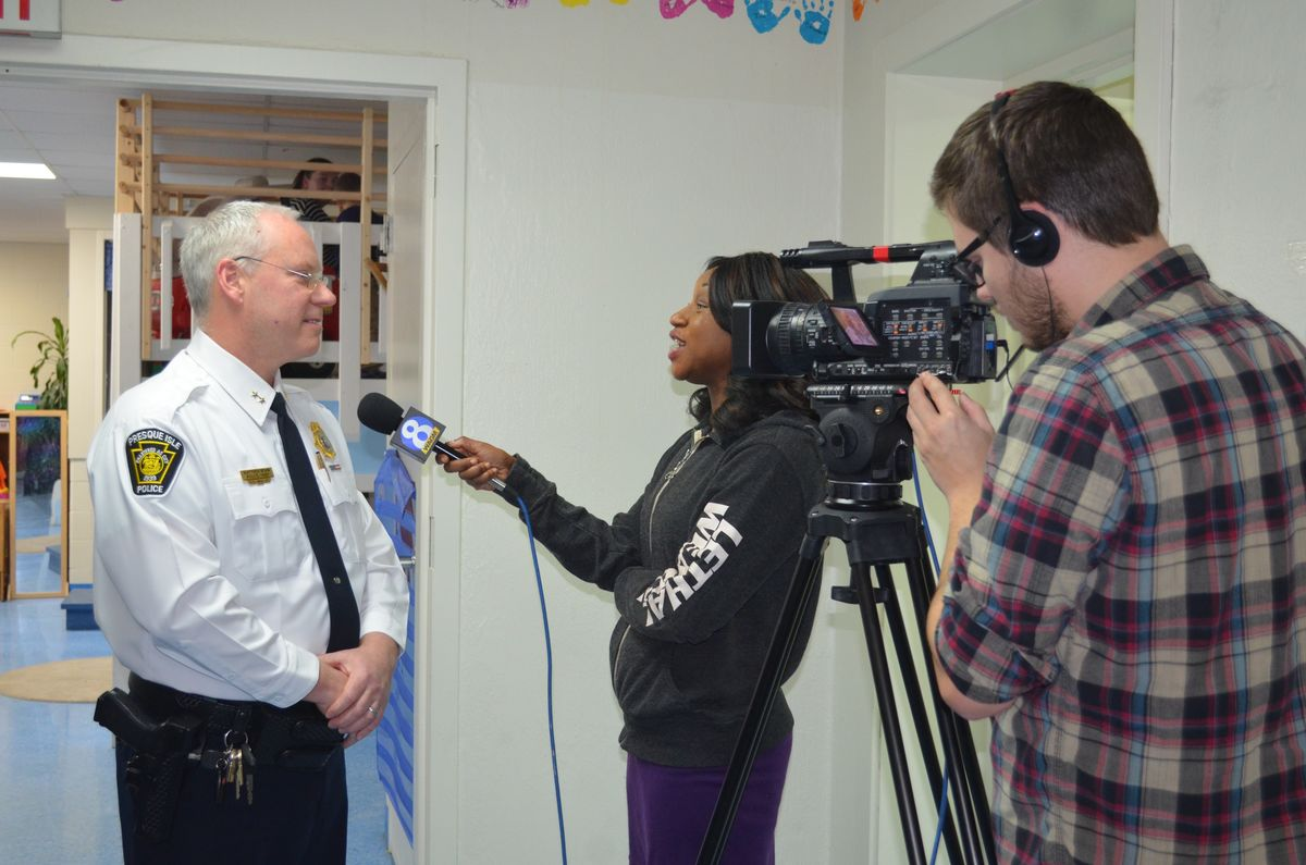 Shawn Cunningham from WAGM-TV News interviews Presque Isle Chief of Police Matt Irwin about the importance of high quality early learning.