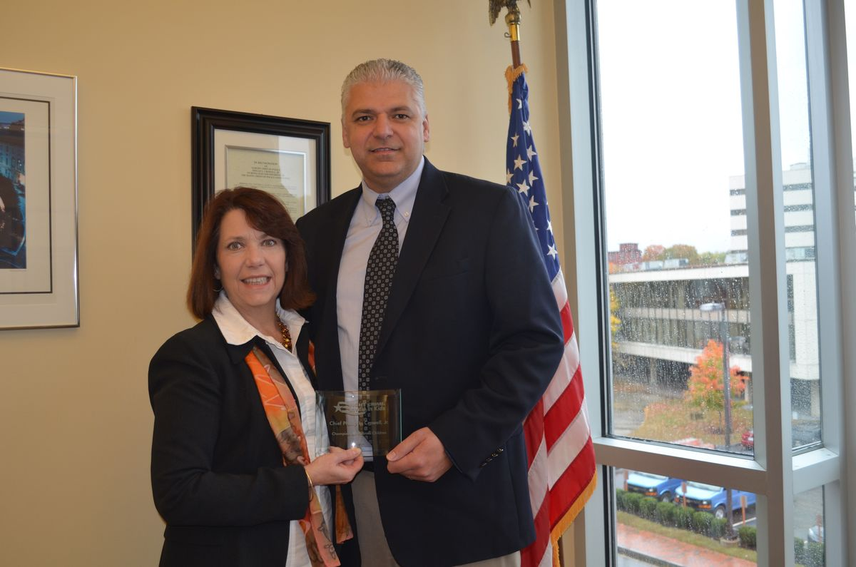 Maine Fight Crime: Invest in Kids State Director Kim Gore presenting Auburn Chief Phil Crowell with the 2016 Champions For Children's Award.